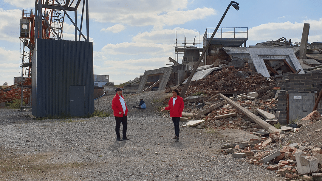 EMTs explore surroundings in earthquake rubble